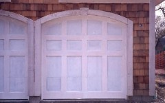 Unfinished single arch garage door without windows