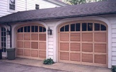 Unique arched dual garage door with windows