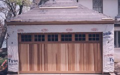 Contemporary custom cedar panel garage door wtih windows