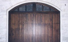 Custom arched garage door - dark stain with windows